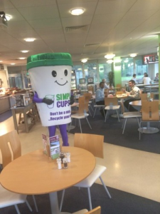 Simply Cup's Cupbert mascot in a canteen